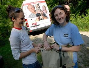 volunteers securing collected specimen