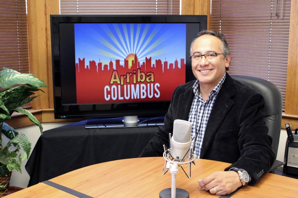"Augusto Saenz sits at the ""Arriba Columbus"" set."