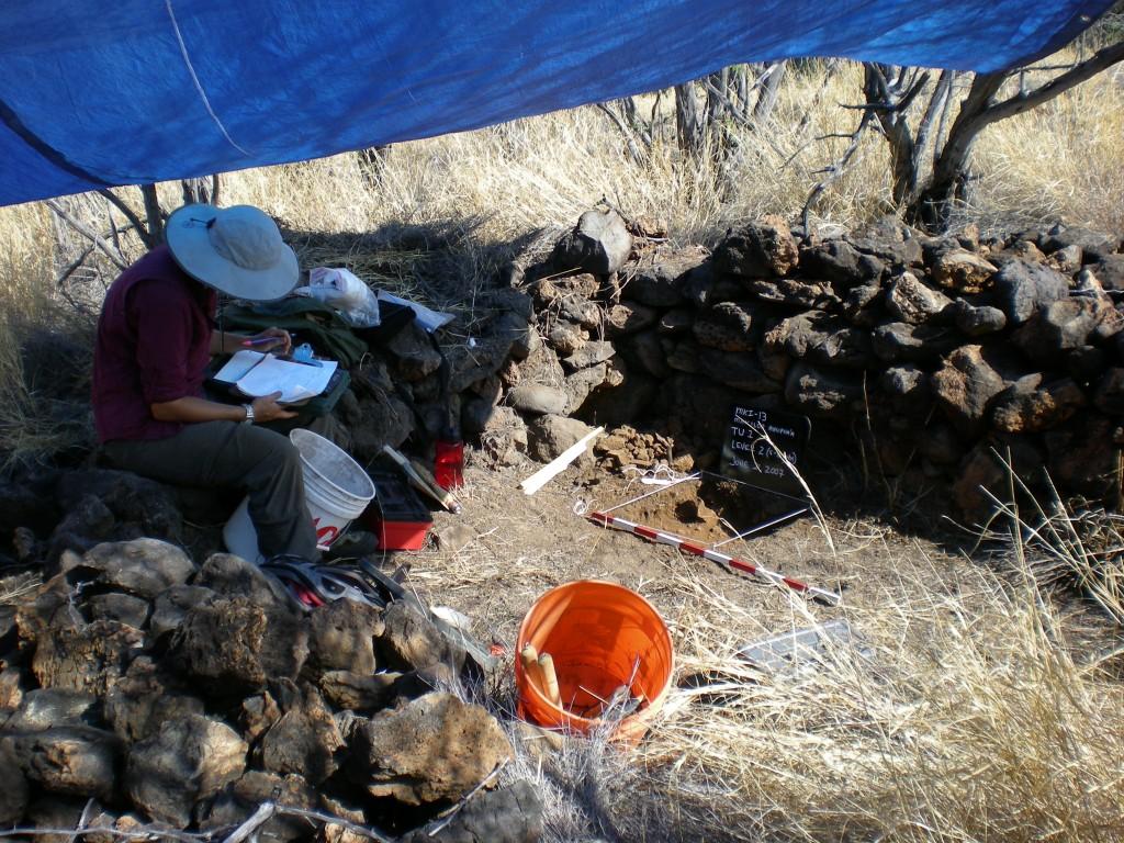 Julie Field recording archaeological sites along the leeward coast of Kohala, Hawaii