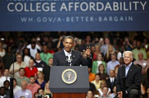 SCRANTON, PA - AUGUST 23: U.S. President Barack Obama (L speaks at an event as U.S. Vice President Joe Biden (R), looks on at Lackawanna College on August 23, 2013 in Scranton, Pennsylvania. Obama is on his second day of a bus tour of New York and Pennsylvania to discuss his plan to make college more affordable, tackle rising costs, and improve value for students and their families. (Photo by Jessica Kourkounis/Getty Images)