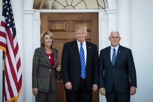 Betsy DeVos with Donald Trump and Mike Pence