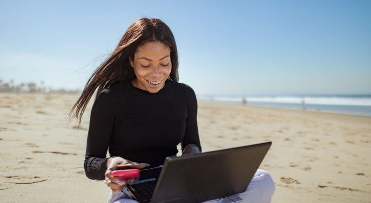 woman looking at her computer