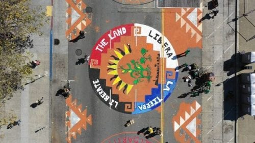 Cause Awareness using large scale graphics on the street during protest