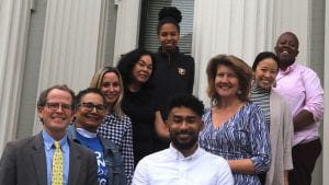 McCarthy Center staff pose in front of their office building