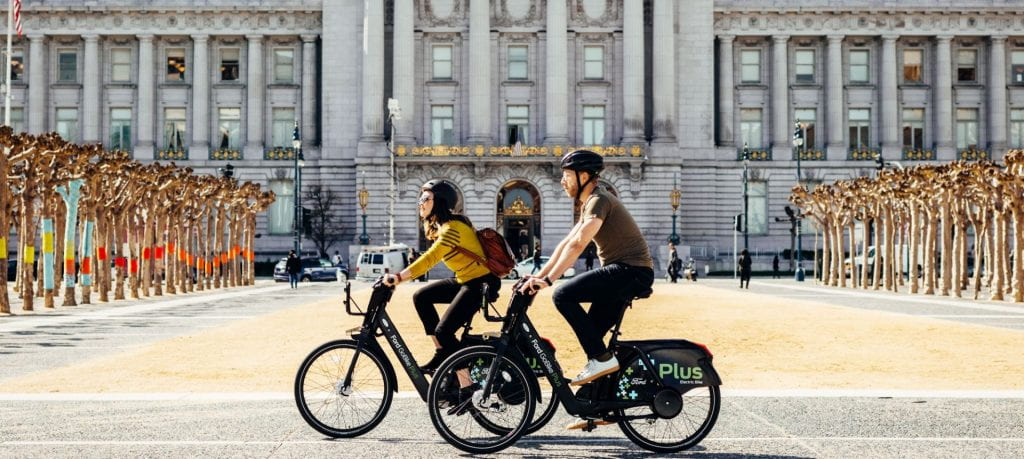 Two people cycling on electric bicycles