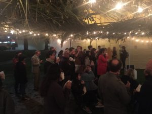 Viewers of the Digital Canvas inside the Open Doors Sukkah