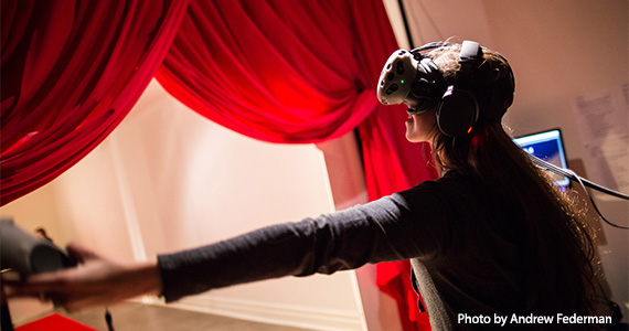 Participant wearing Virtual Reality headset at installation