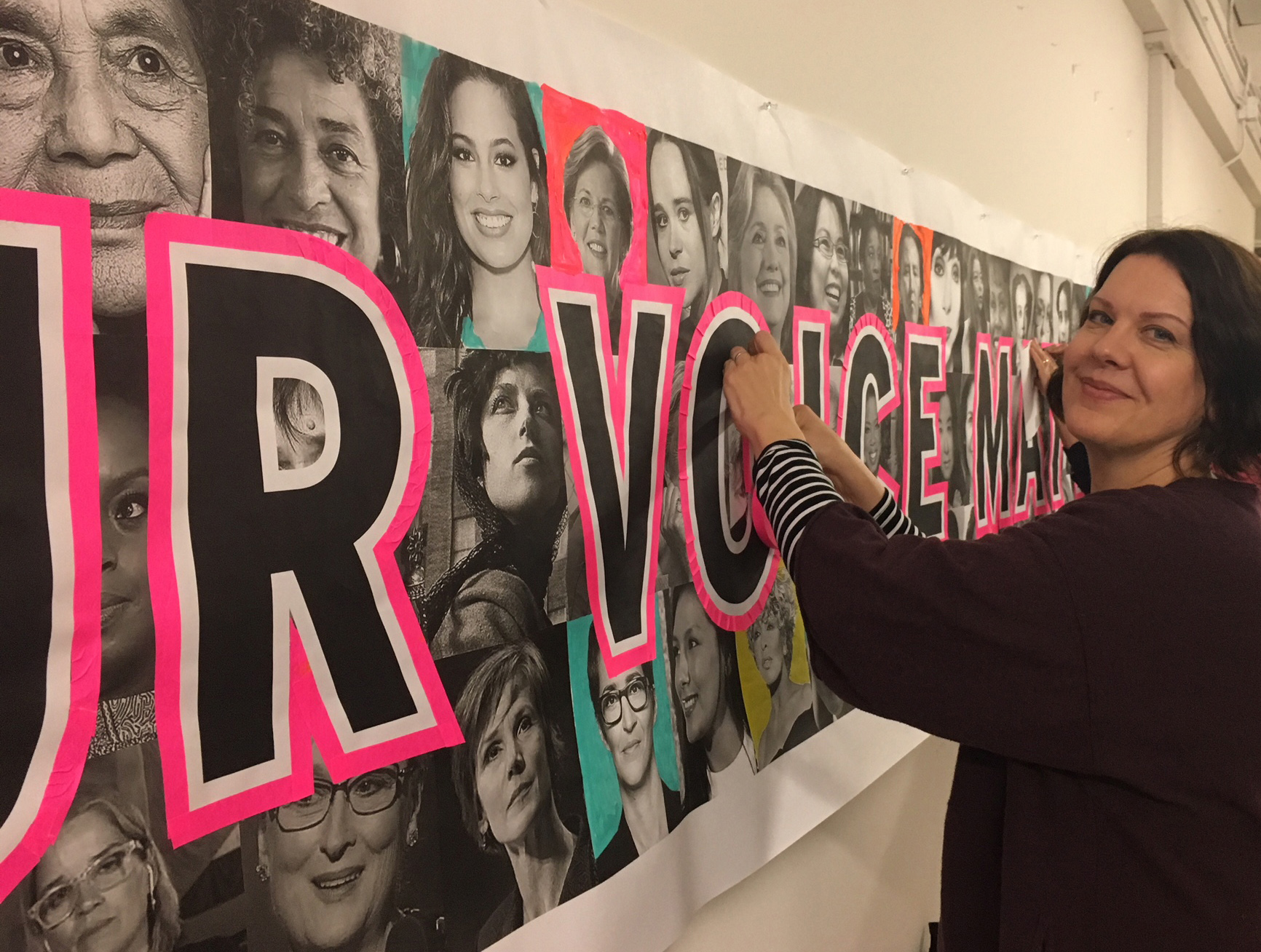 Professor Sandra Kelch works banner in preparation for the San Francisco Women's March 2018.