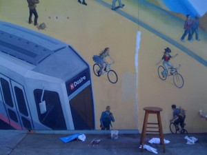 mural section showing San Francisco streetcar and two exuberant cyclists