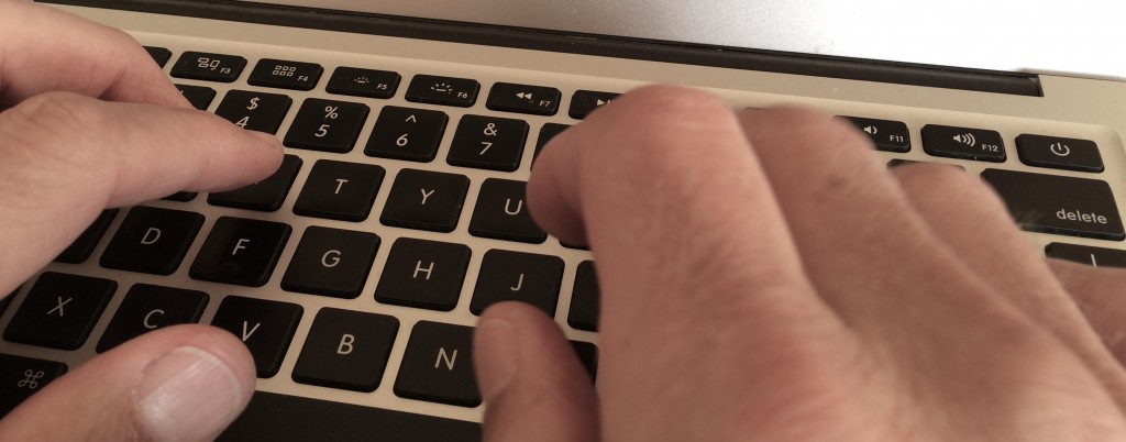 hands at a laptop keyboard