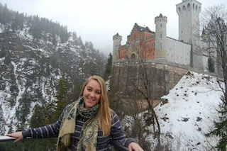 COMS major and Benefit intern Alyssa in front of her castle