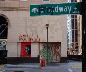 """Street sign painted with text """"Floydway"""""""