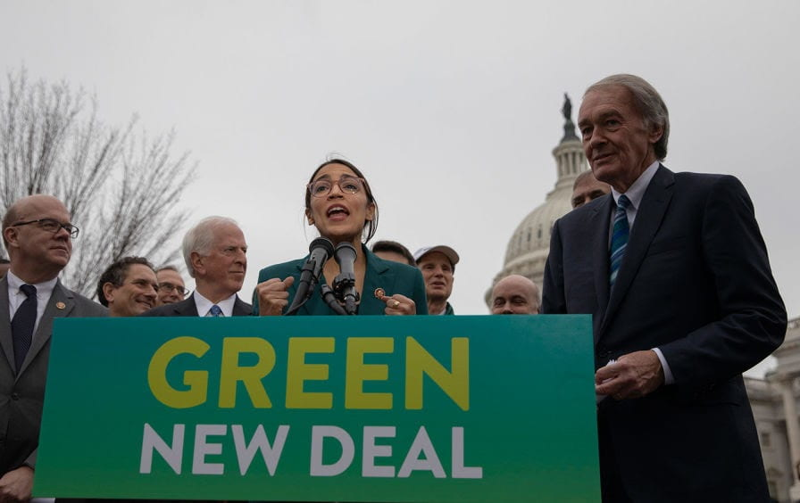 """Alexandria Ocasio-Cortez speaks during a press conference to announce the """"Green New Deal"""" on February 7, 2019. (AP Images / dpa, Alex Edelman)"""