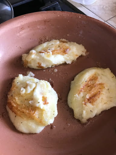 Three mashed potato dollops that have been slightly browned.