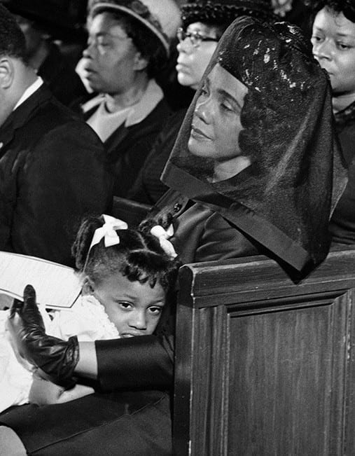 Coretta Scott King at the funeral of Martin Luther King, comforting their 5-year-old daughter, Bernice.