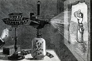 XJF440660 Magic Lantern projecting a maternal scene (engraving) by English School, (19th century); Private Collection; (add.info.: A popular form of entertainment in the Victorian era, the magic lantern was a precursor to moving pictures and modern day cinema; The lantern works by projecting light through a photographic slide which then passes through a lens, is magnified and projected onto a surface; The lantern in this image is powered by an oil lamp; Lanterns were often used for trickery, in particular to create the illusion of ghosts and dead spirits;); English, out of copyright