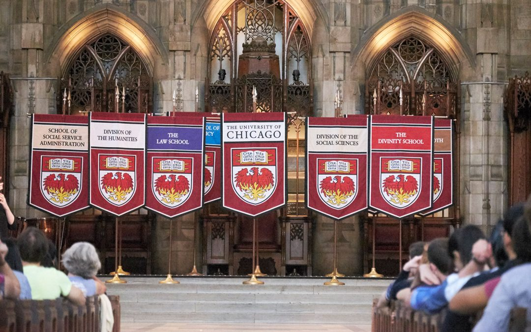 Departmental banners are displayed at Convocation in Rockefeller Chapel