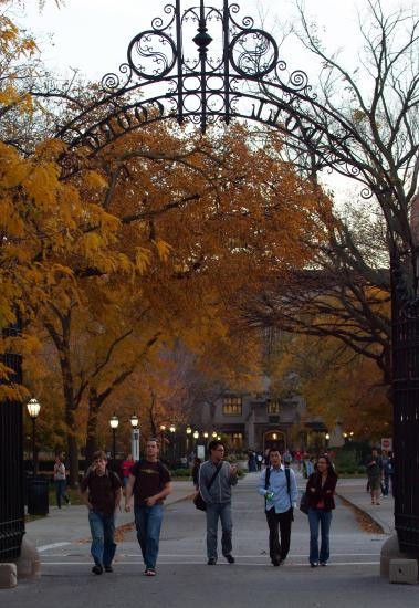 A view of students passing under Hull gate in autumn