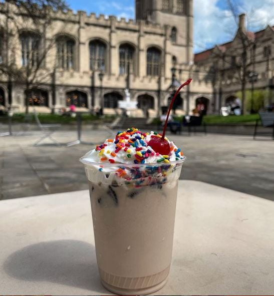 Chocolate Shake with sprinkles, whip cream and a cherry in the quad