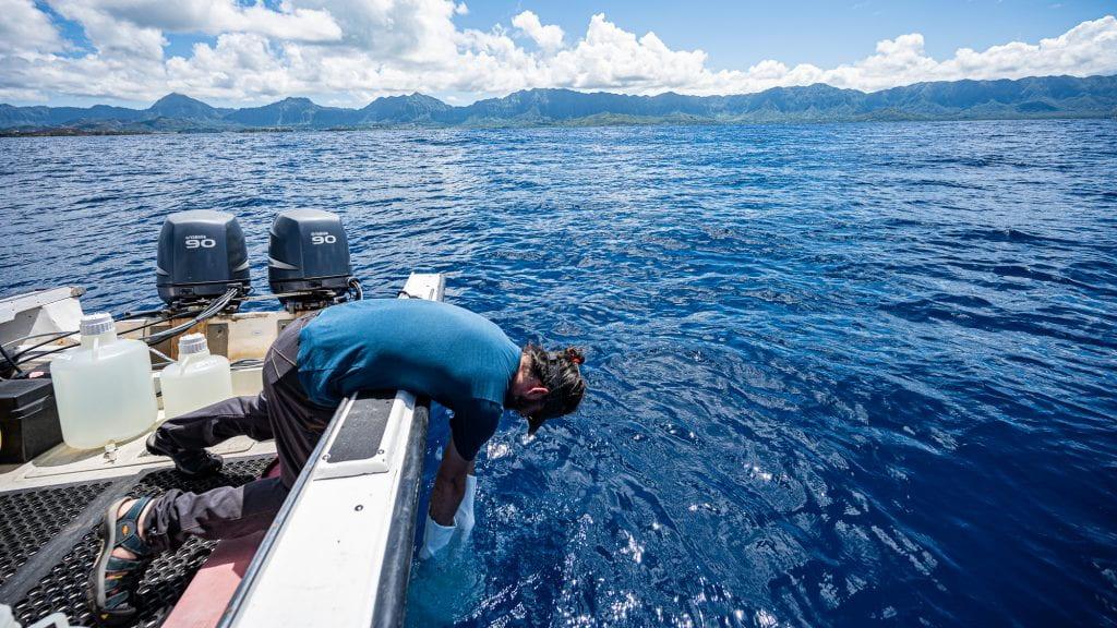 Meren collecting water samples