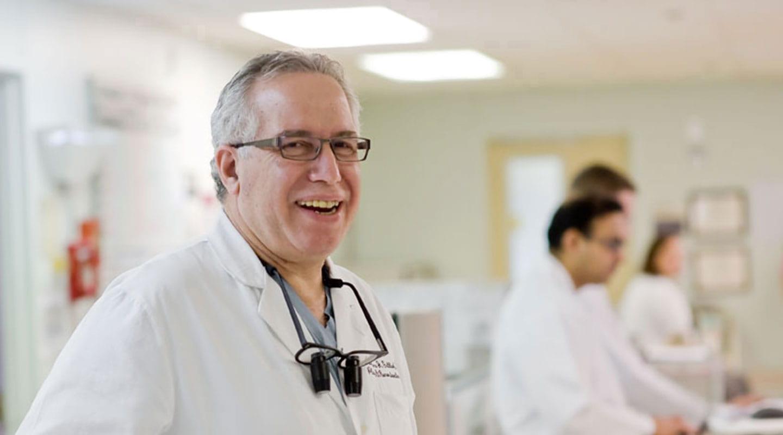Dr. Gottleib smiling in an interior hallway