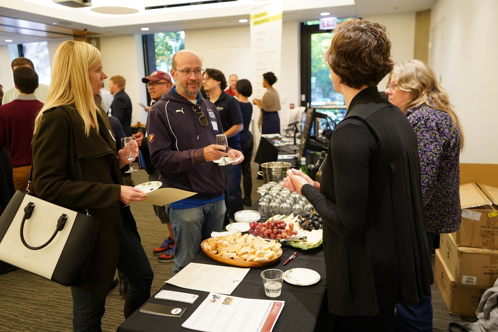 Bridget Madden (right foreground) of the Visual Resources Center speaks with attendees
