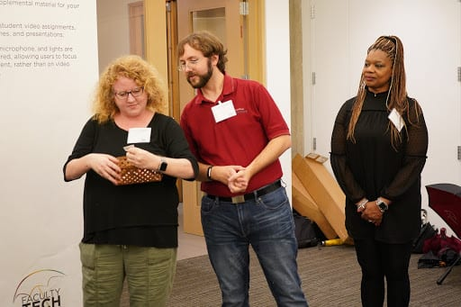 Members of the Faculty Technology Receptions planning committee (left to right: Astrid Fingerhut, Jason Edelstein, and Cheryl Walker) hold a drawing for door prizes.