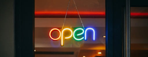 Colorful Sign Reading Open