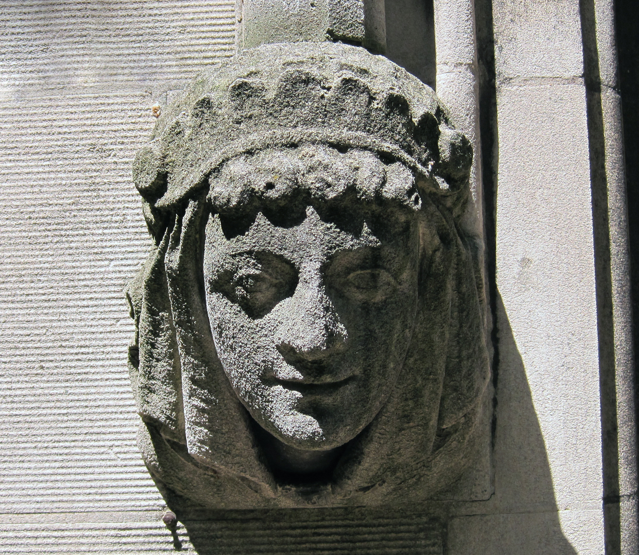 Gargoyle head - woman with crown