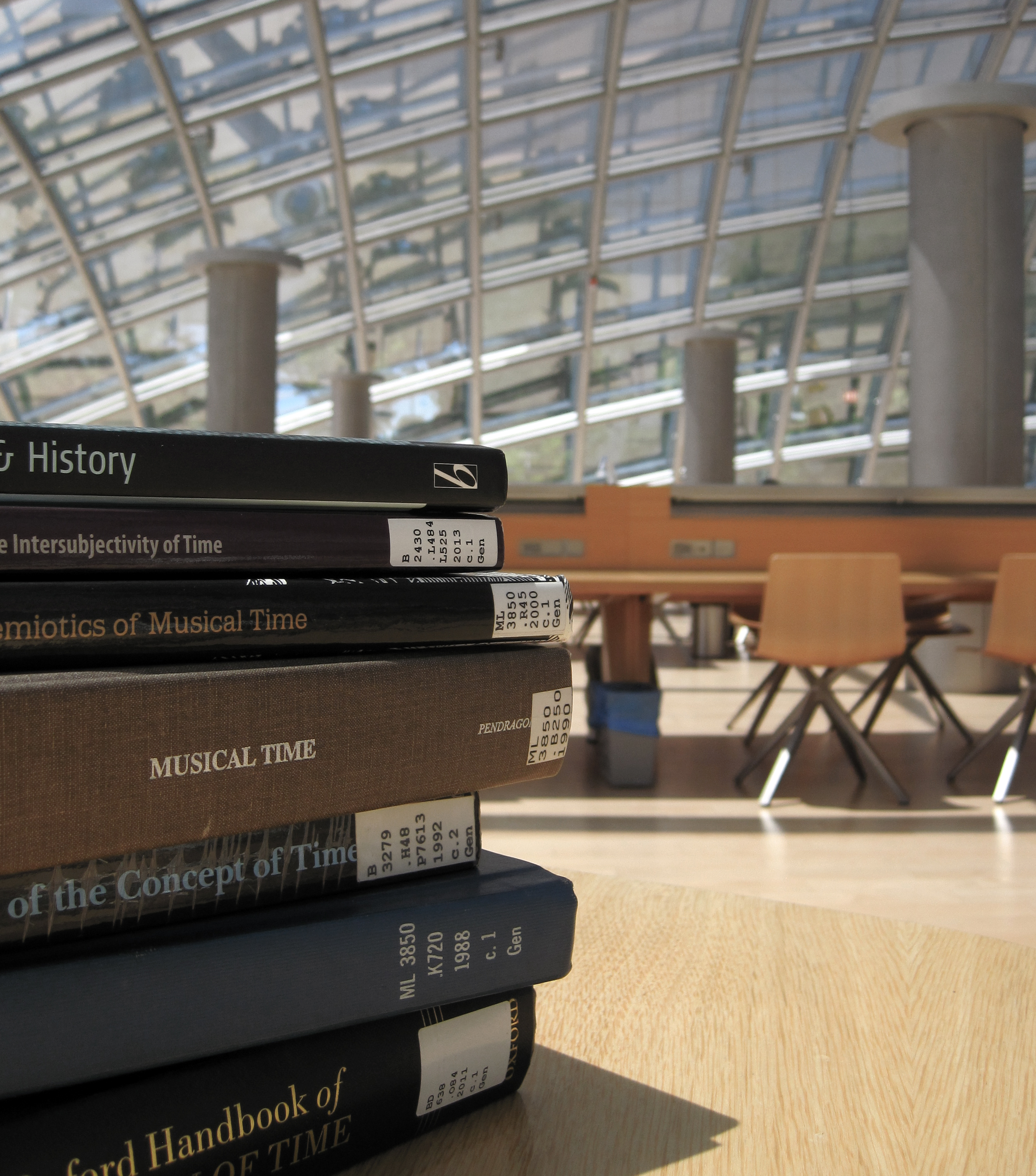 Books on a table in the Mansueto reading room