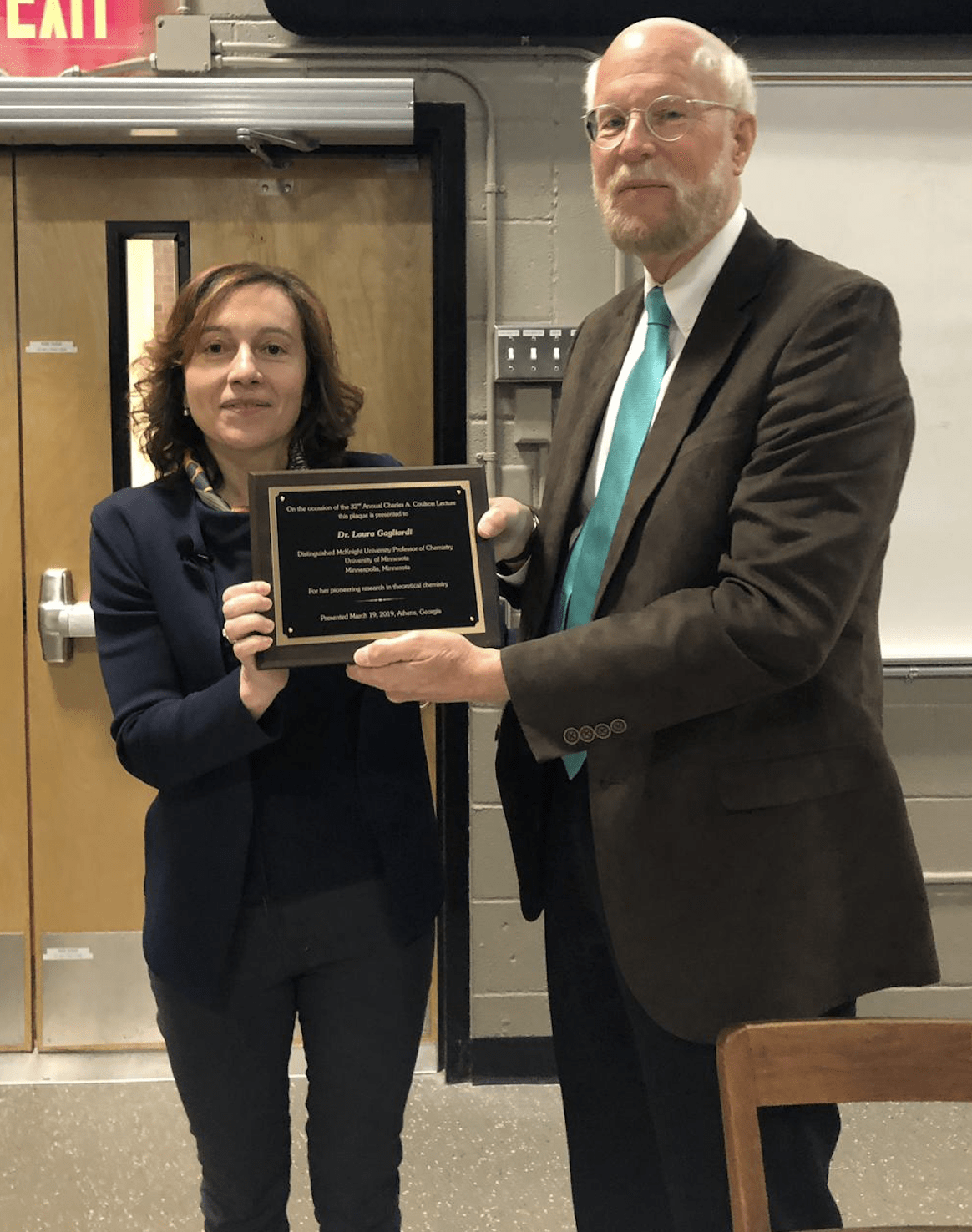 Laura receives Coulson plaque from Professor Henry F. Schaefer III