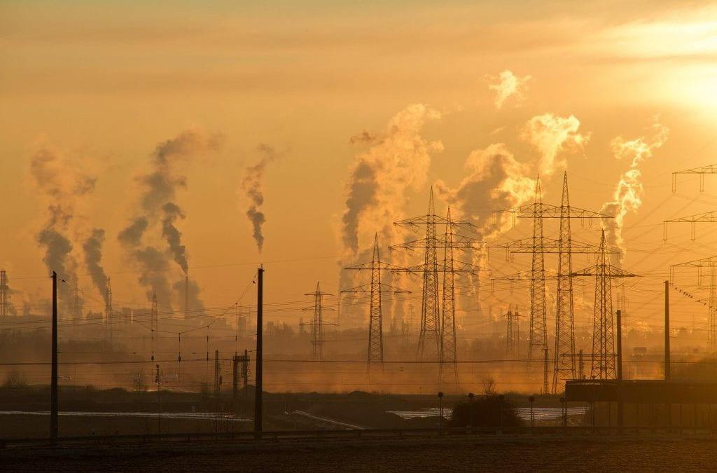 Factories emitting smoke into the sky