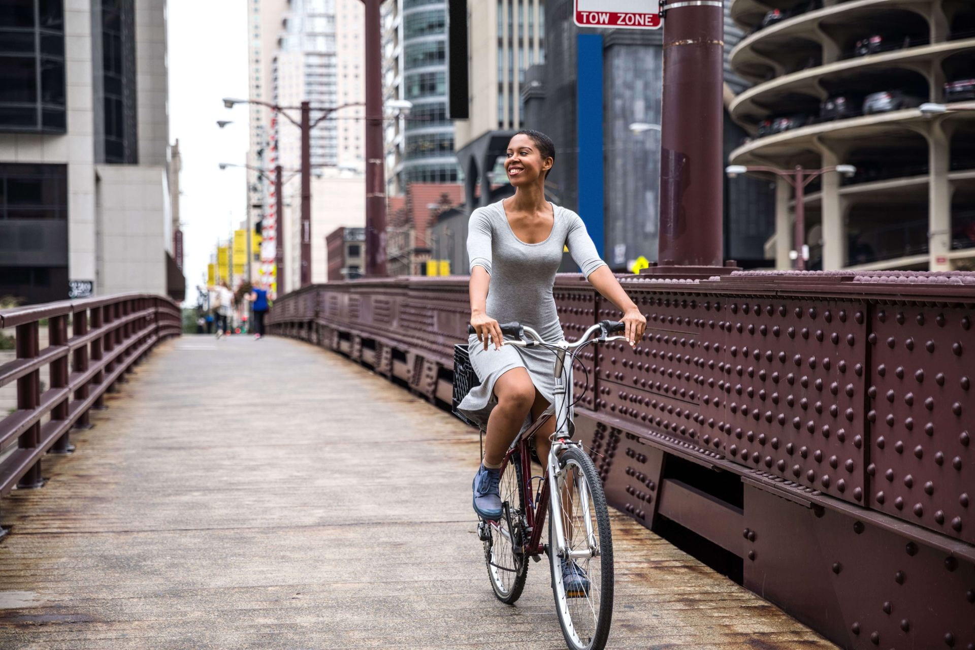 Smiling women on a bicycle