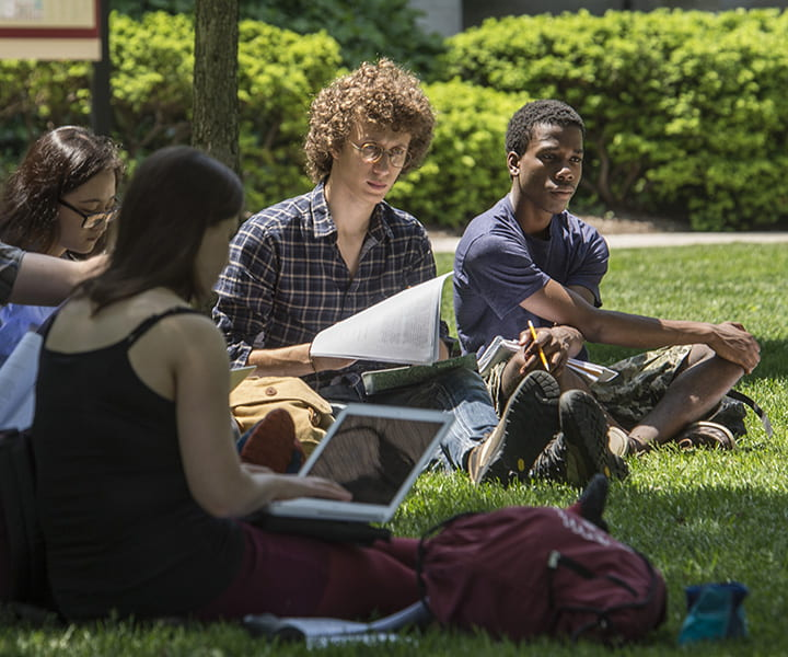 Students sitting in main quad