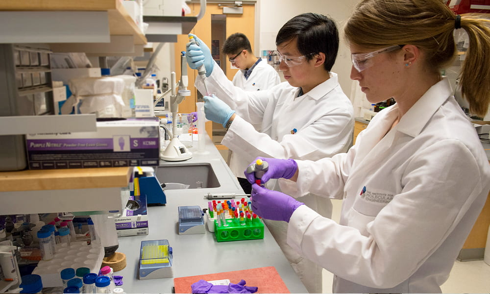 People in labcoats working in a laboratory