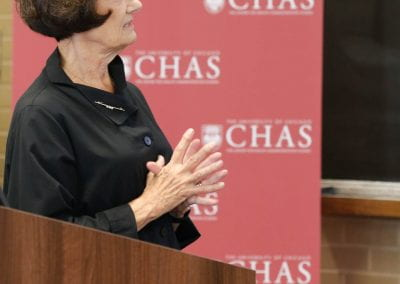 Jeanne Marsh standing at a podium at the 2019 CHAS Paris Conference