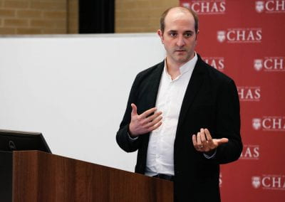 Attendee speaking to an audience at the 2019 CHAS Paris Conference