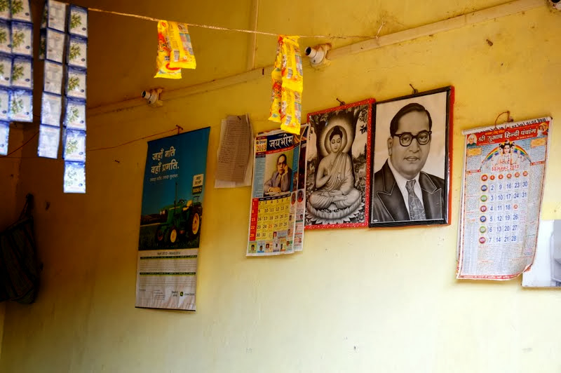 Dr. B.R. Ambedkar, and a portrait of Gautam Budhha hangs in a shop in Balaghat, Madhya Pradesh.