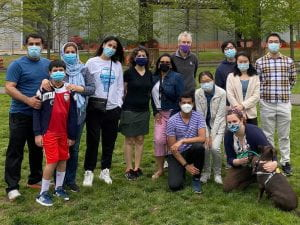 Group picture taken at Penn Park. Everyone is masked except Daisey the dog, who is sitting at the bottom right of the image.