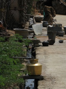 1024px-India_-_Rural_-_03_-_drinking_water_and_waste_water_meet_on_the_street_(2564575360)