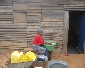 This woman is saving money by doing her own laundry. - Luphumlo Klaas