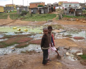 These children are playing in polluted water. This is bad because they can get a disease. -Abongile Hole