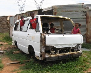 In these next photos, children are driving cars. Either they are playing on cars that were bought or found, or they use their imagination. These children are very creative. - Anele Bokuva