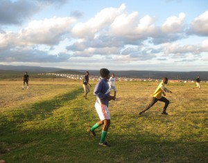This is the field where we train. The dent in the middle is very dangerous. We see this as a risk but we like to play here because the other fields are flooded or have too much dust. - Mfundo Klaas