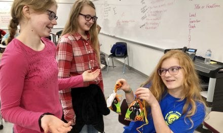 StuCo distributes Boo Bags on Halloween
