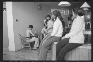 Image of several students in Fayerweather snack bar, some playing music