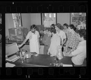 a photograph of several students and an instructor in a neuroscience lab
