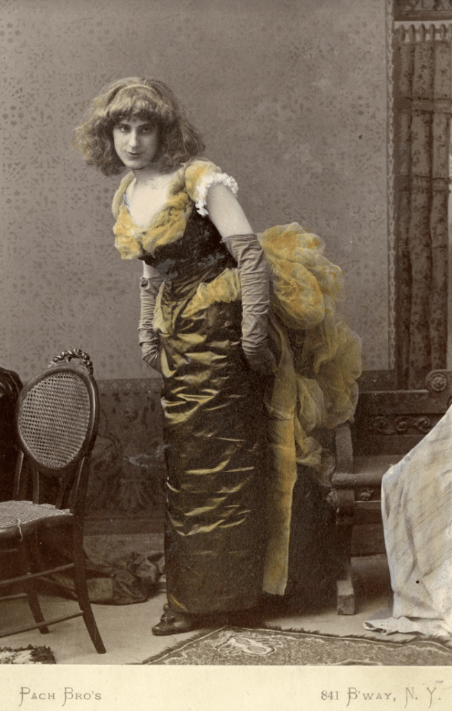 Hand painted black and white photograph of Clyde Fitch in a dress