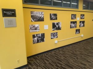 black and white photographs on yellow wall