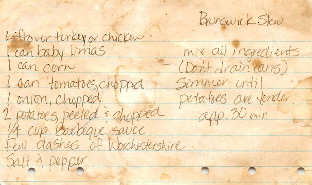 recipe for Brunswick Stew handwritten on a browned index card with five small binder holes at the bottom